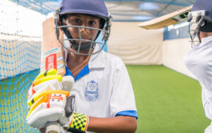 Photograph of a Student student holding a cricket bat