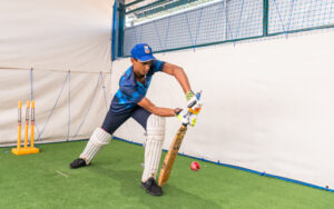 A student of SIS practicing cricket