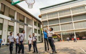 Students of SIS playing basketball