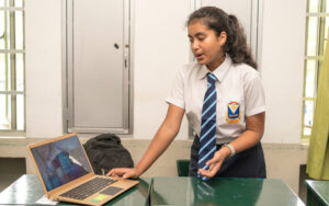 Student of SIS doing a presentation using a laptop