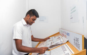 A student of SIS reading a newspaper