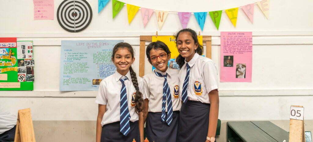 Students of SIS smiling at the camera